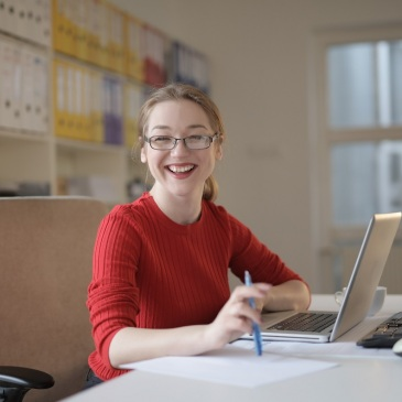 woman in red sweater at office